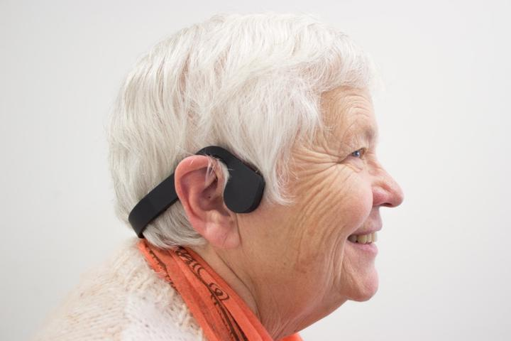 Older adult wearing bone-conduction headset connected to Prospero